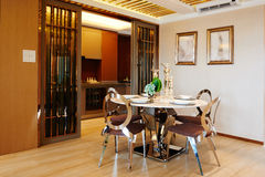 Modern dining room. With table and chairs on marble floor board Royalty Free Stock Photo
