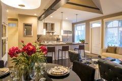 Modern dining room table set for dinner Stock Images