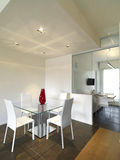 Modern dining room with tile floor mixed to wood royalty free stock photo
