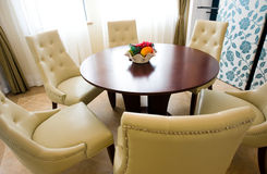 Modern dining table. And chairs in dining room Stock Photo