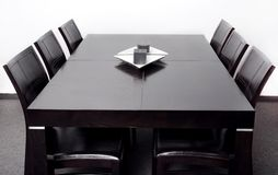 Modern dining table Stock Images