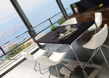 Modern dining table against floor to ceiling window with landscape view Stock Images