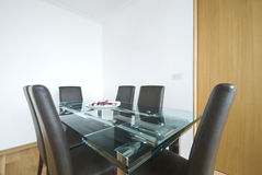 Modern dining table with leather chairs Royalty Free Stock Photos