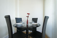 Modern dining table set up Royalty Free Stock Images