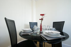 Modern dining table set up with flowers Stock Photo
