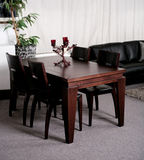 Modern dining table in an stylish house Royalty Free Stock Photos