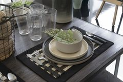 Modern dinning interior on wooden table stock image