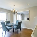 Dinning room with table and chairs Royalty Free Stock Photos