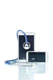 Modern Disease, digital tablet, cell phone and stethoscope Royalty Free Stock Image