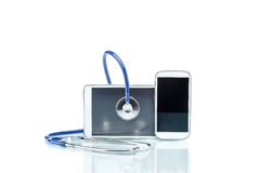 Modern Disease, digital tablet, cell phone and stethoscope Royalty Free Stock Photos