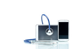 Modern Disease, digital tablet, cell phone and stethoscope Stock Photo