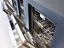 Modern dishwashers on display at store royalty free stock photography