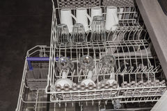 Modern dishwashing machine with clean dishes Royalty Free Stock Photo