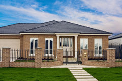 Modern display home. With manicured lawn stock photo