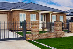 Modern display home. With manicured lawn royalty free stock image