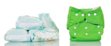 Modern disposable diapers and clean diaper isolated on white. Stock Image
