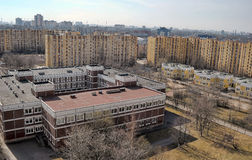 Modern district with standard panel houses and school. S, St. Petersburg, Russia Stock Images