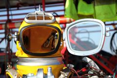 Modern diver helmet. (open face an yellow color stock photography