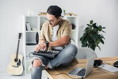 Modern dj working with MPC pad Royalty Free Stock Photos