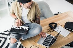 Modern dj working with MPC pad Stock Images