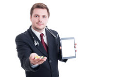 Modern doctor holding pills and white blank tablet screen Stock Photography