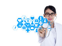 Modern doctor with medical interface Royalty Free Stock Photos