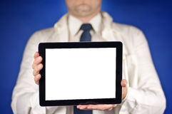 Modern doctor wearing tie showing blank tablet screen Royalty Free Stock Photo