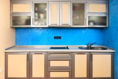 Modern domestic kitchen interior design. With venetian plaster background Stock Photo