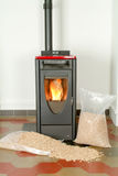 Modern domestic pellet stove with a burning flame Stock Image
