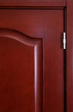 Modern door fragment. Red wooden room door fragment Royalty Free Stock Photos