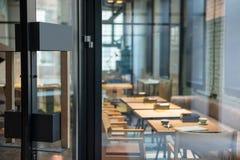 Modern Door Handle On The Wooden Glass Door In Front Of The Cafe. Stock Photo