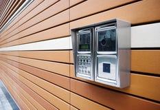 Modern Door Intercom. Shiny stainless steel intercom ata modern apartment block stock photos