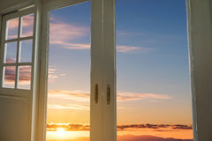 Modern door with window frames with sunrise sky view backgrounds Stock Photo