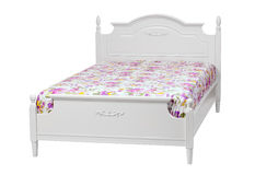 Modern double bed with cotton sheet over white. With clipping path Royalty Free Stock Photography