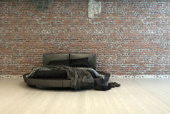 Modern double bed with throws and shoes Stock Photography