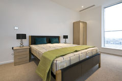 Modern double bedroom with king size bed. And bedside tables Stock Image