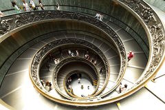 Modern double helix staircase in Vatican Museum. VATICAN, ITALY - JULY 16:  The modern double helix Bramante staircase in Vatican museum showing the two access Stock Photography