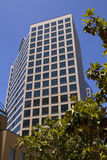 Modern Downtown City Office Buildings. Modern city corporate office buildings for lease Stock Image