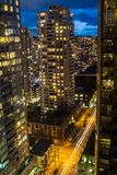 Modern downtown from the roof of a skyscraper at night. Modern North American downtown streets from a tall tower at night when nobody is on the street Royalty Free Stock Photo