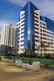 Modern downtown San Diego office building. Modern city office building in downtown San Diego, California, seen from sand floored rooftop bar and lounge across Royalty Free Stock Photography