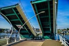 Modern Draw Bridge being opened at Zaandijk over the Zaan River Stock Image