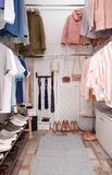 Modern dressing room with different stylish clothes. And accessories stock image
