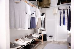 Modern dressing room with different stylish clothes. And accessories stock images