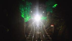 Modern driver-less metro train rush forward, along night Malaysia, Overground railway, bright road lights at night stock video