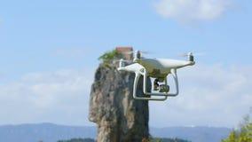 Modern drone flying filming ancient Katskhi Pillar in Chiatura travel to Georgia stock video footage