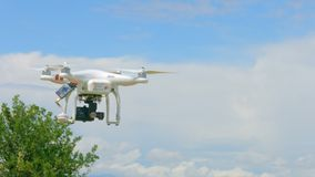 Modern drone flying in sky, professional video filming, innovation technology. Stock footage stock video