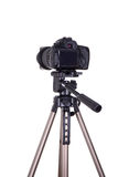 Modern dslr camera with blank screen on tripod isolated on white. Background Stock Photography