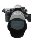 Modern DSLR camera with lens attached Royalty Free Stock Images