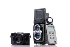 Modern dslr camera, vintage medium format two-lens camera and li Stock Photography