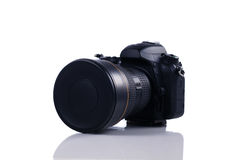 Modern DSLR camera with wide angle lens isolated on white Stock Photos